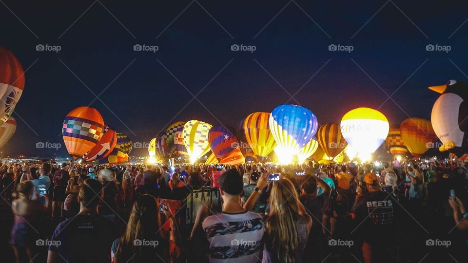 The Balloon Glow at the Great Texas Balloon Race, a field of hot-air balloons lit up at night
