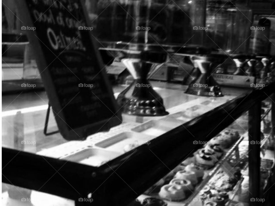 A New York Bakery in black and white. Cakes, cupcakes, chalk board.