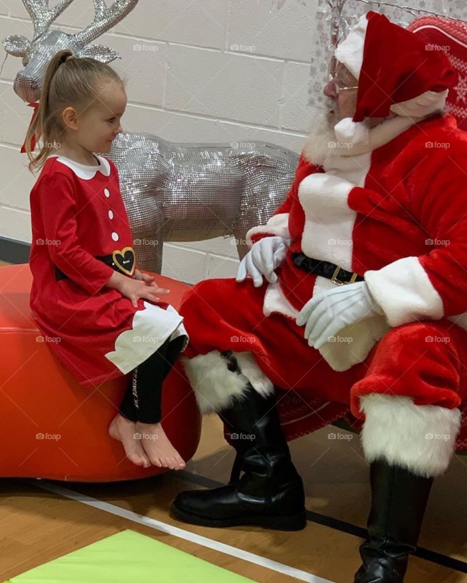 Little girl so interesting what Santa as to say to her