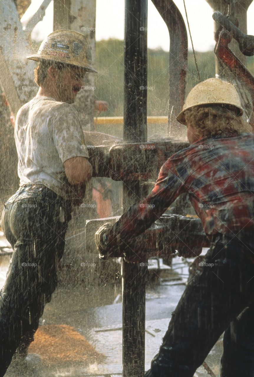 Worker repairing broken pipe at construction site