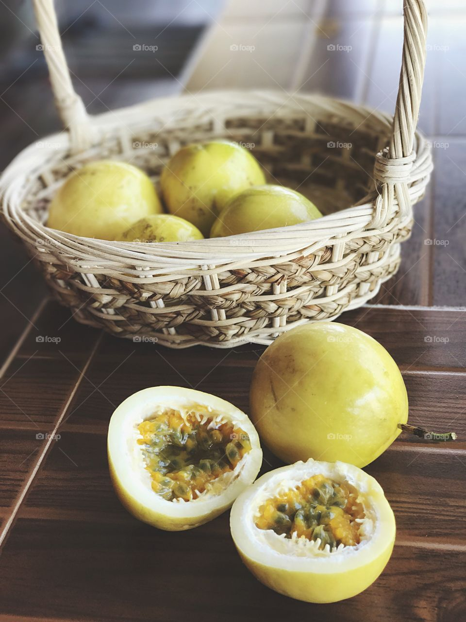 Half-cut passion fruits (Passiflora edulis) in and out of basket