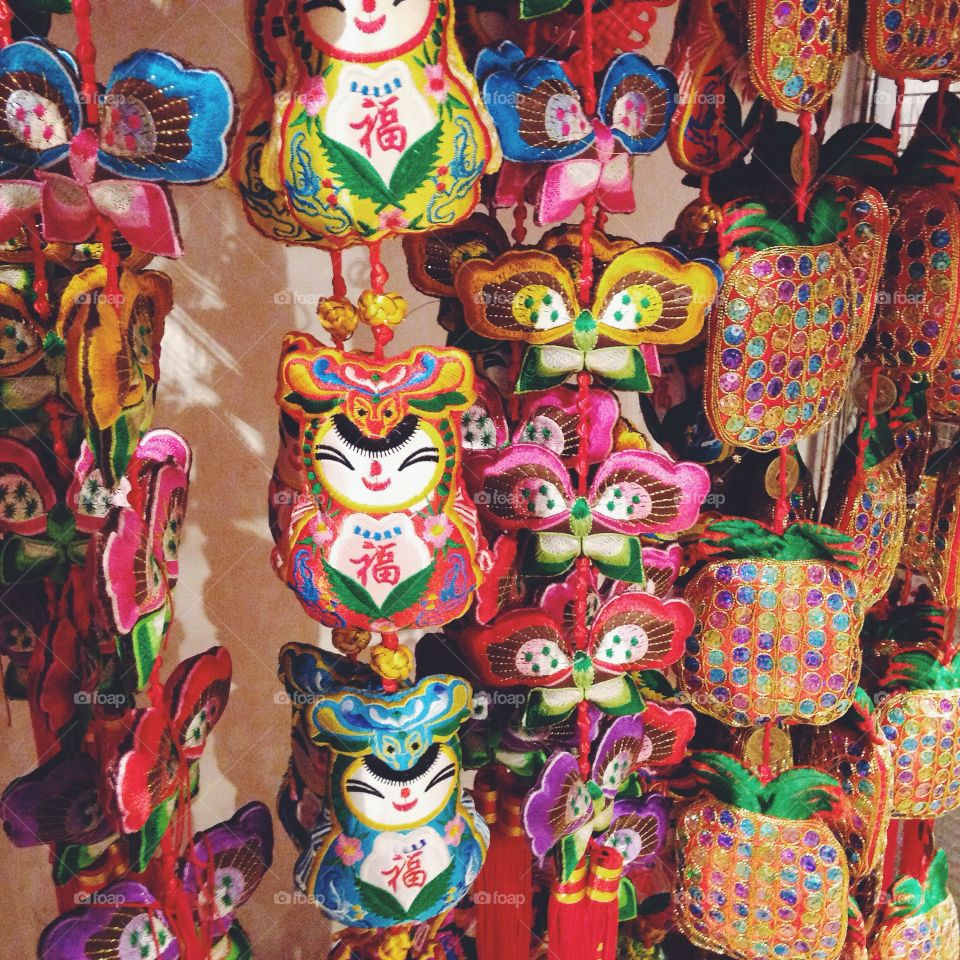 Adorable Chinese New Year Decorations hanging in a shop.