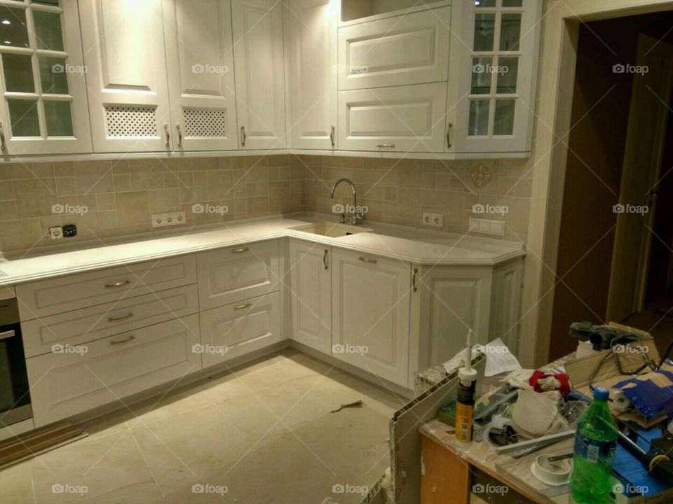white kitchen in repair mess