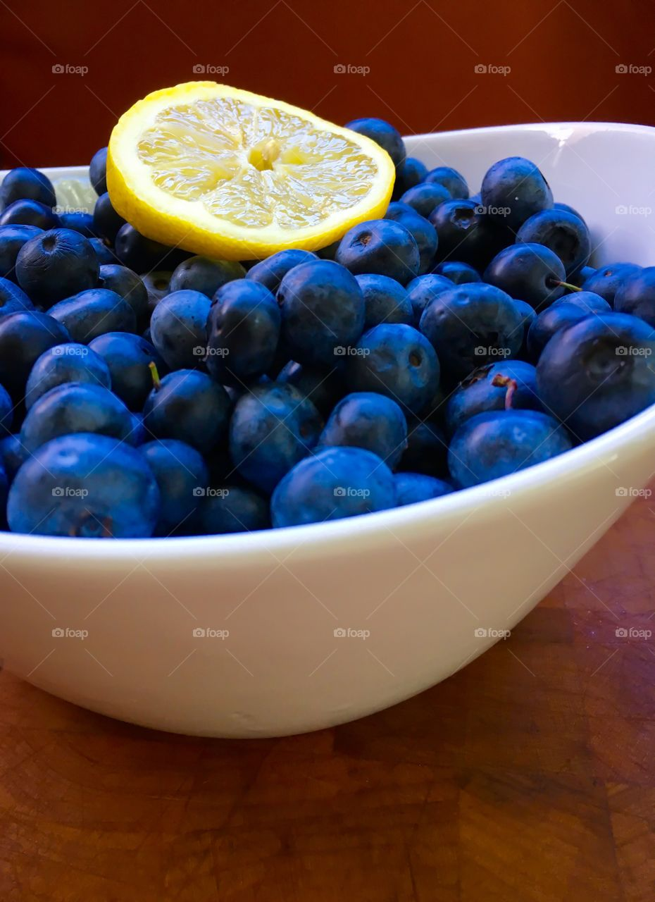 Blue berries in bowl with lime slice