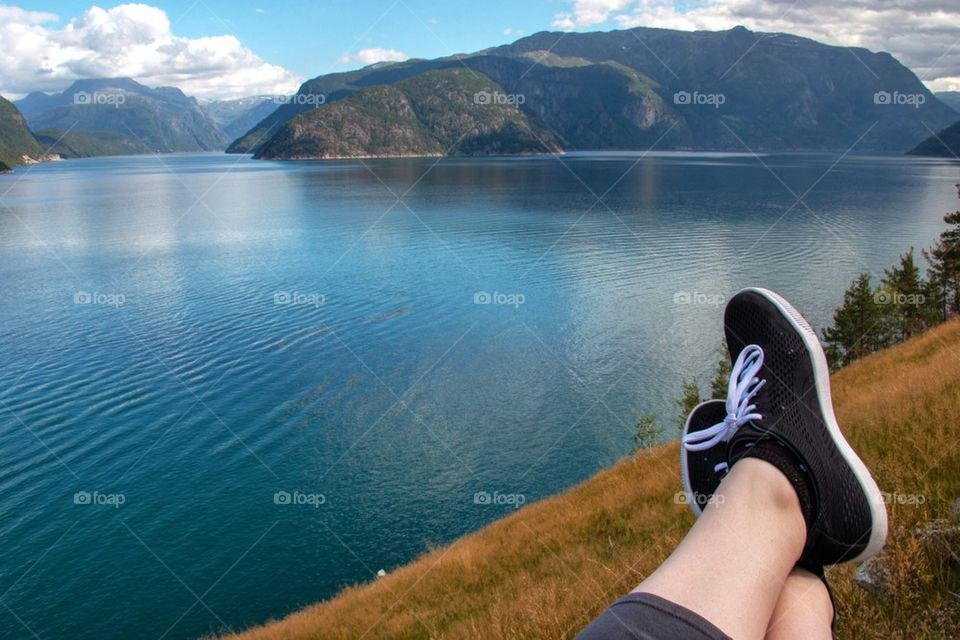 Low section of person at lakeshore, Eidfjord