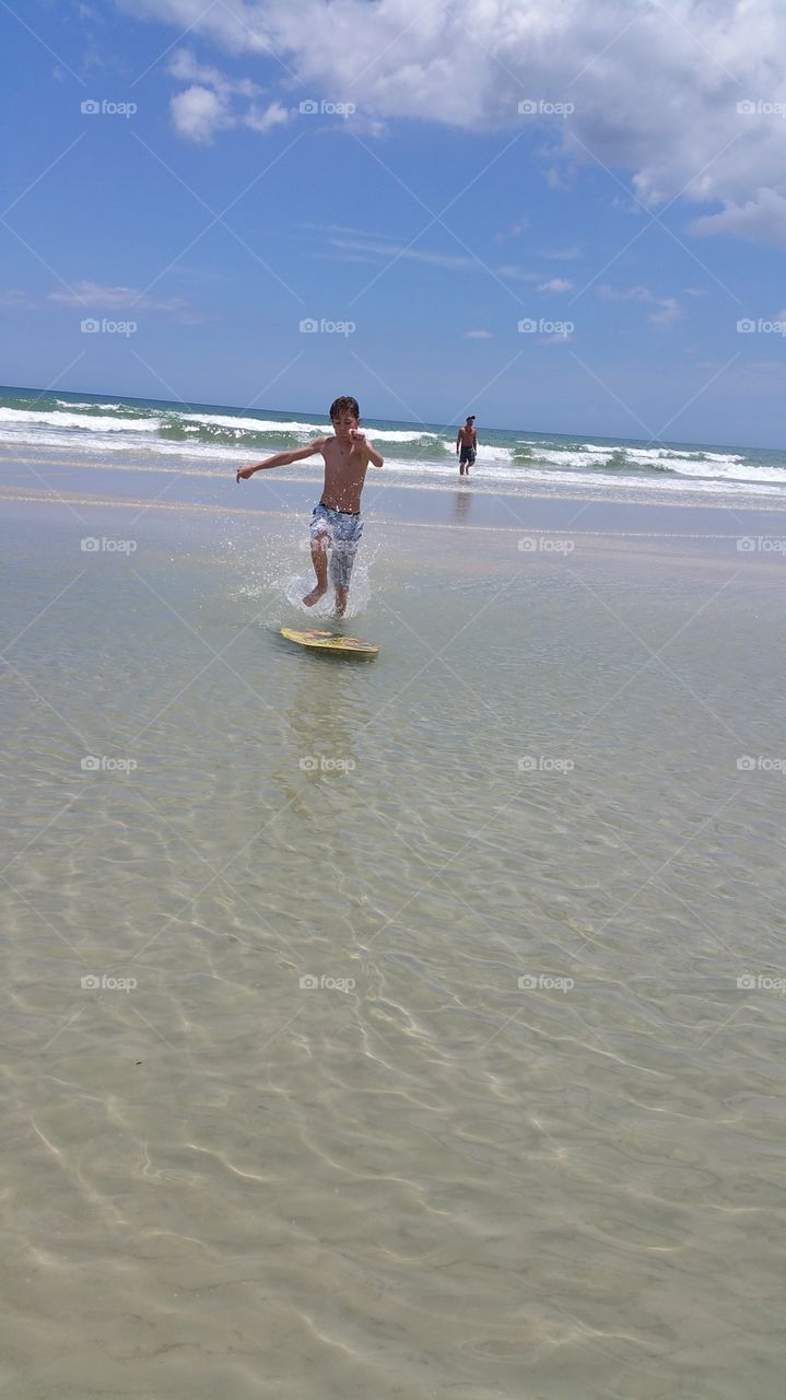 Action Surf. trying out the skim board