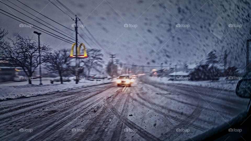 left hand turn during a snow storm.. this was taken from the back passenger seat behind driver