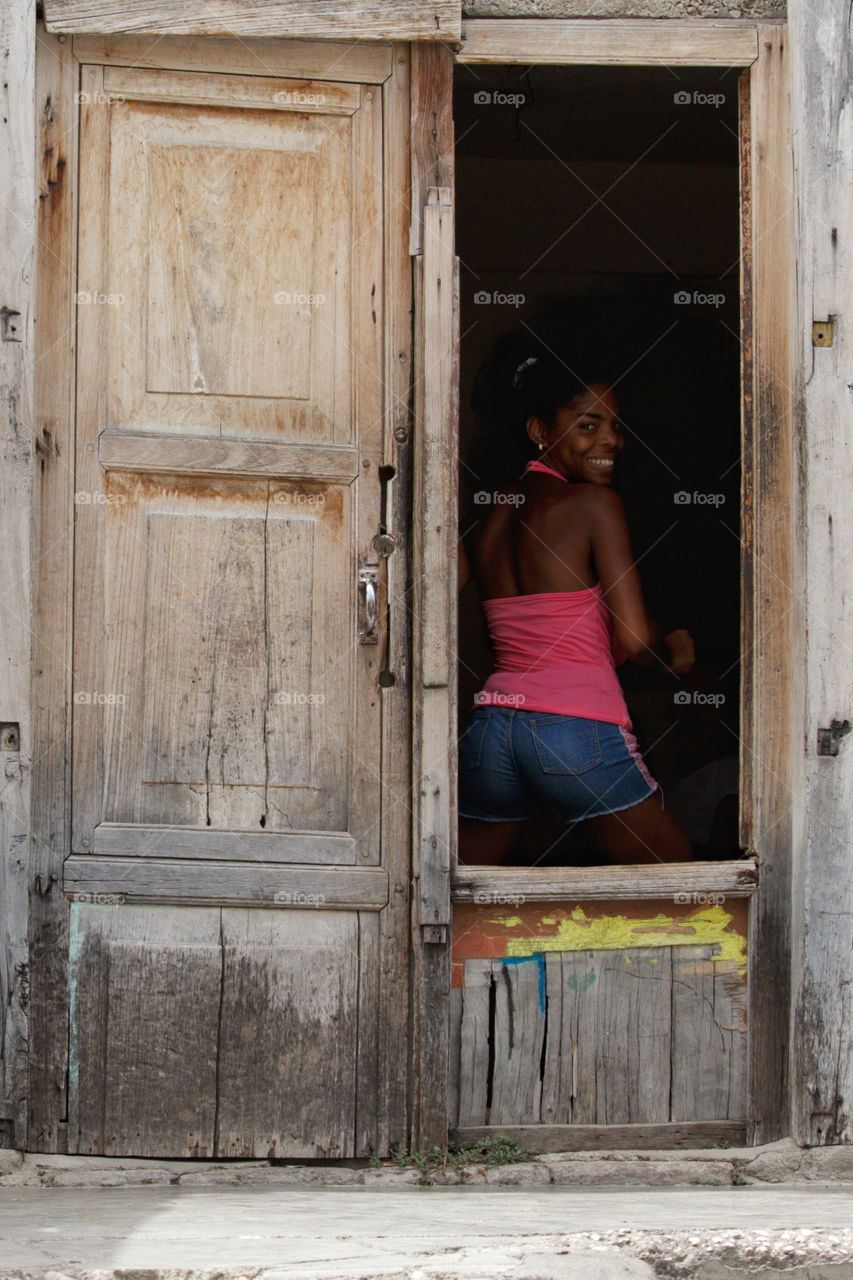 Afrocuban girl happily smiling.
