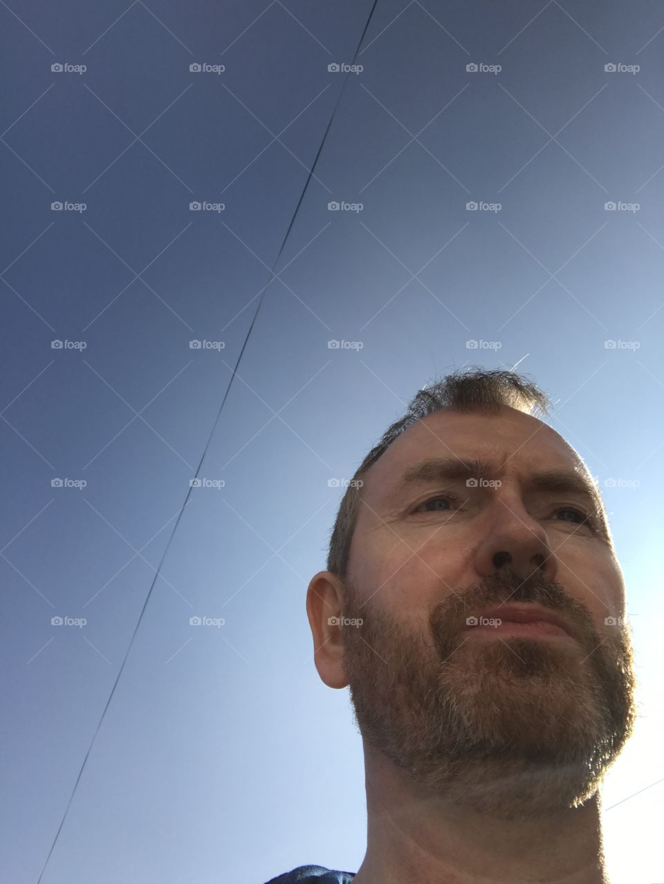 Headshot of a mature man against clear sky