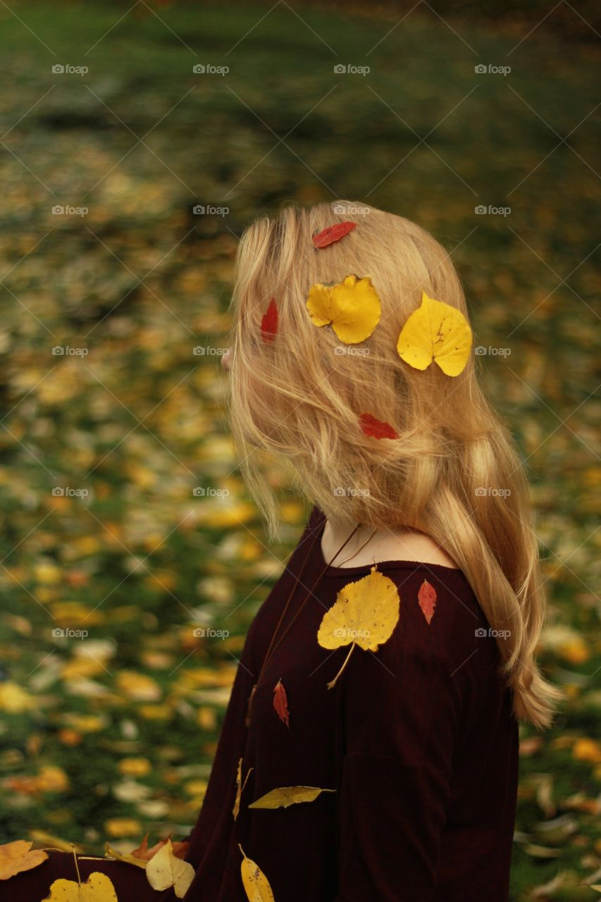 The falling leaves on a girl