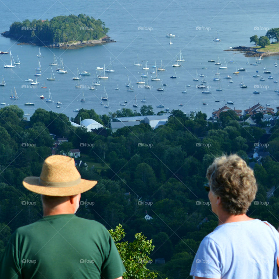 An elderly couple takes a look at sailboats in the Maine coastline! Majestic!