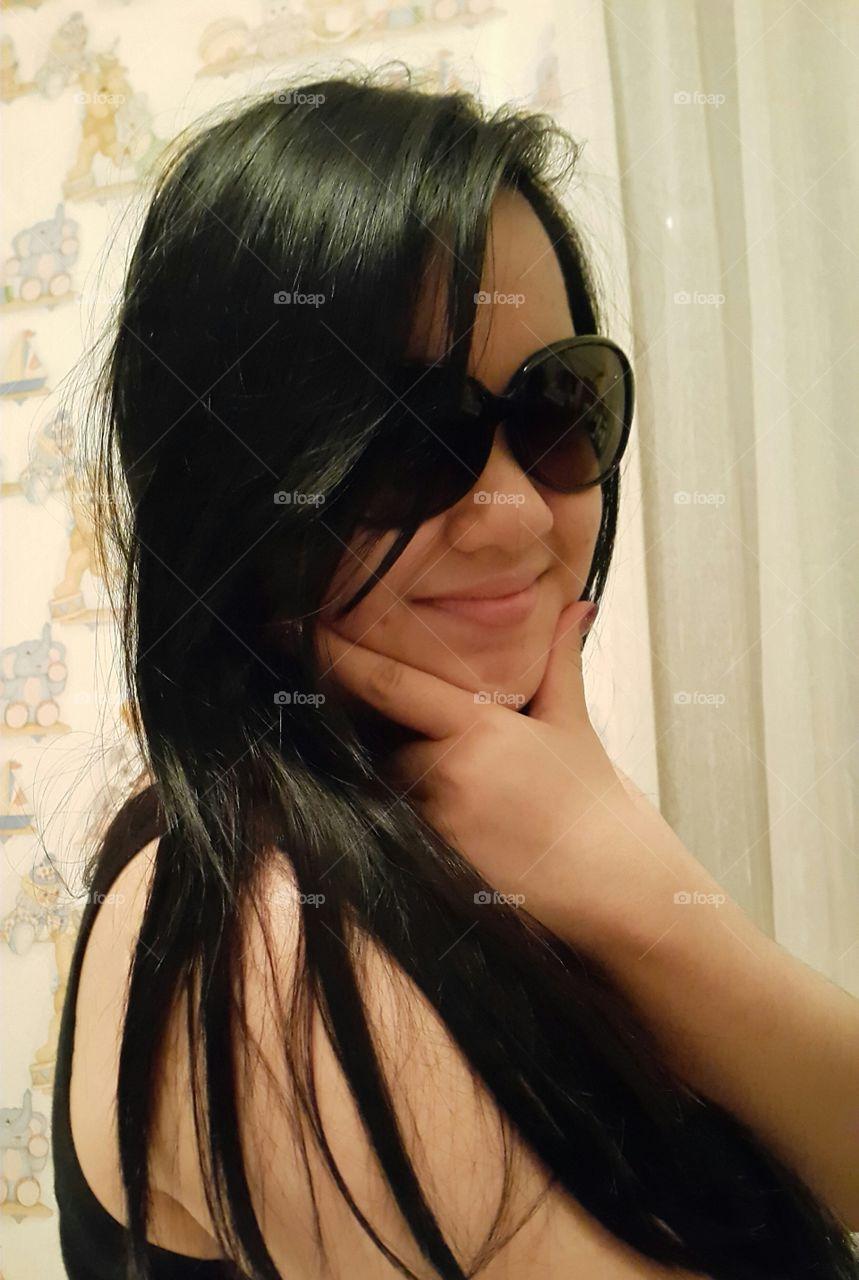 Portrait of fashionable woman wearing sunglasses