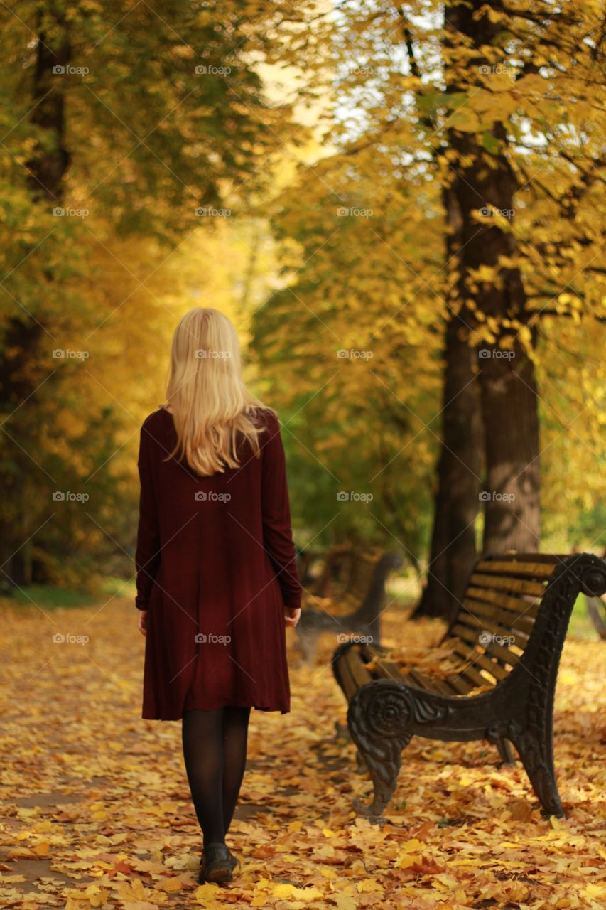 Rear view of woman in autumn