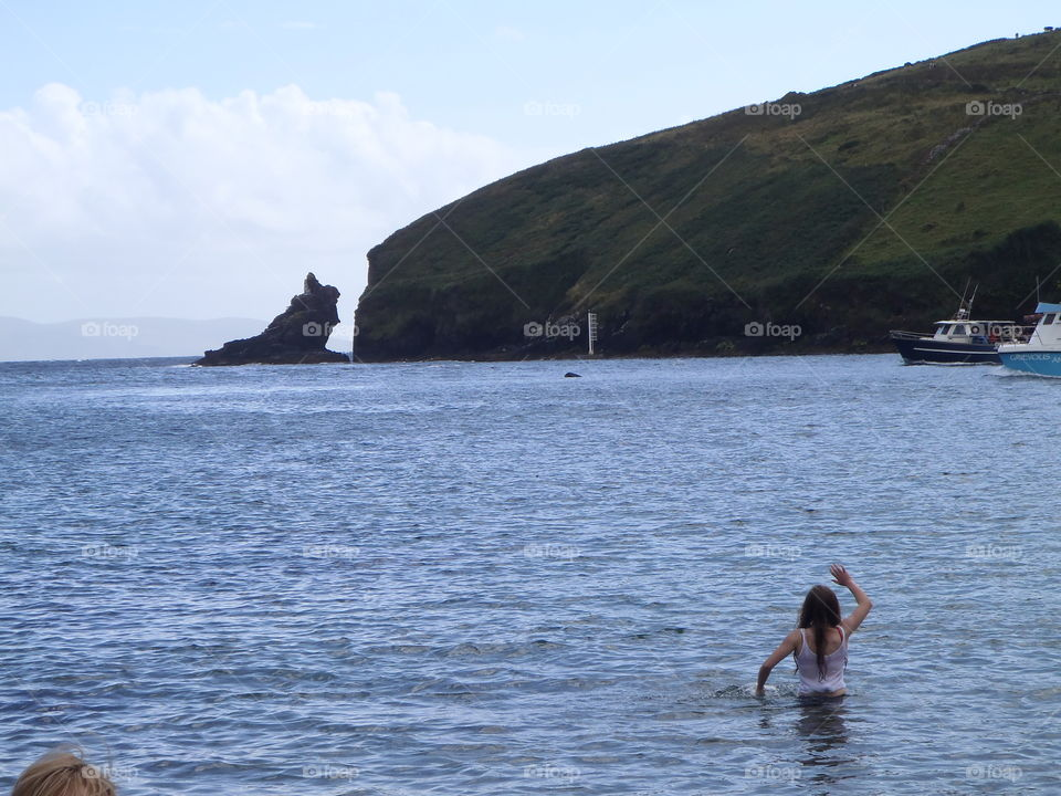 Waiving to the dolphins . Dingle co Kerry Ireland