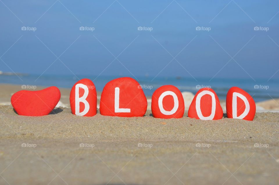 concept of blood on red stones on the beach