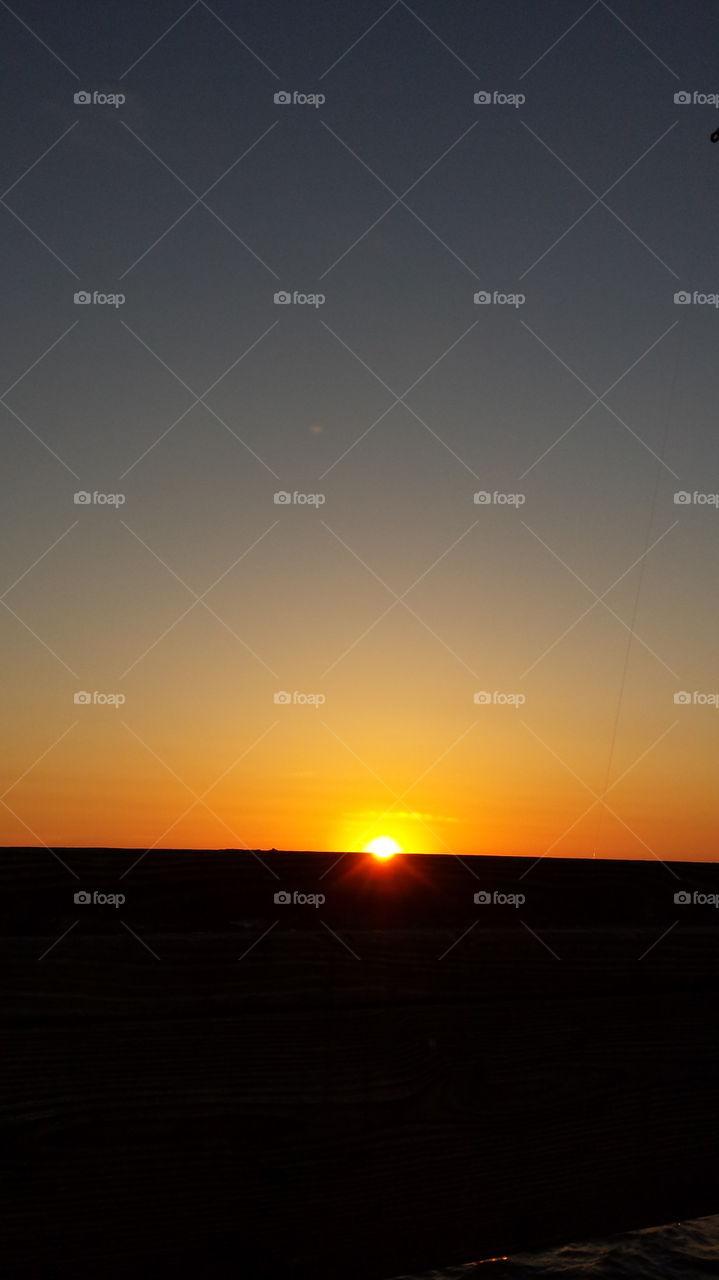 sun rising over the ocean