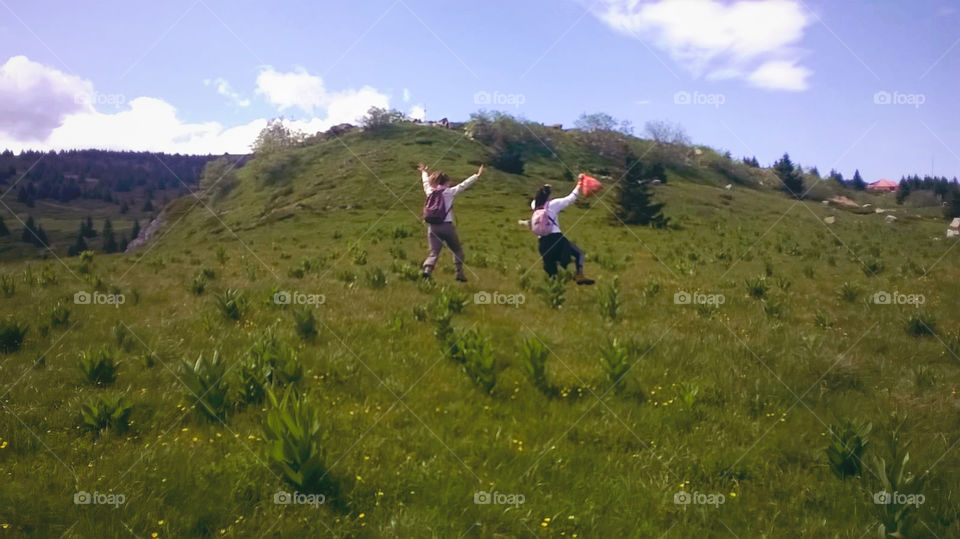 Happiness. Running wild and free on the top of the mountain with lungs full of fresh mountain air. Photo taken during a school trip.