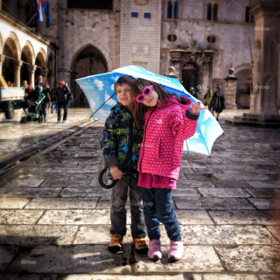 umbrella fun. brother and sister