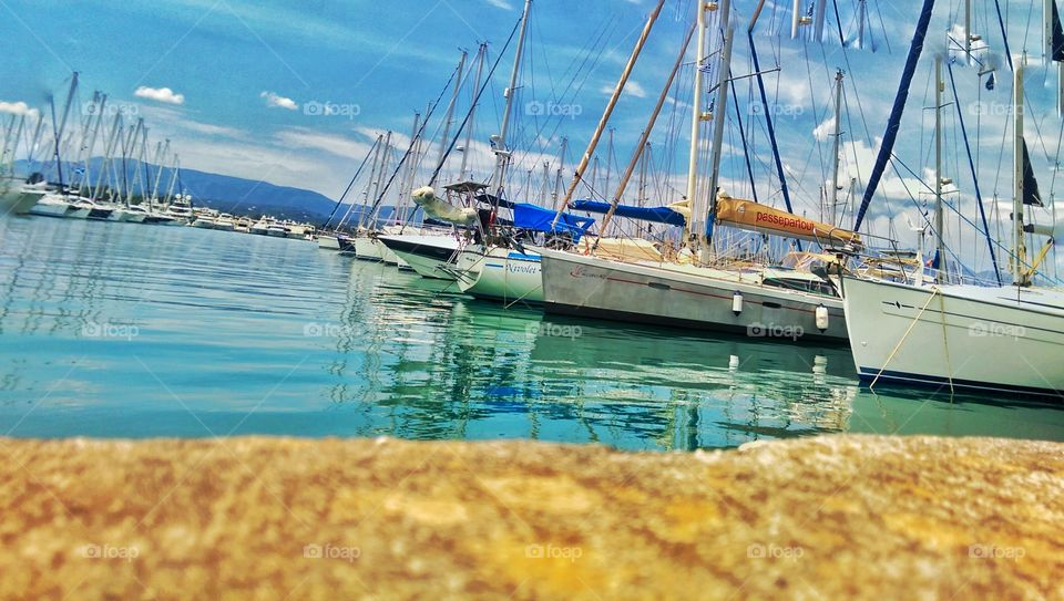 all docked, now let's get loaded and set sail. taken in corfu Greece on holiday