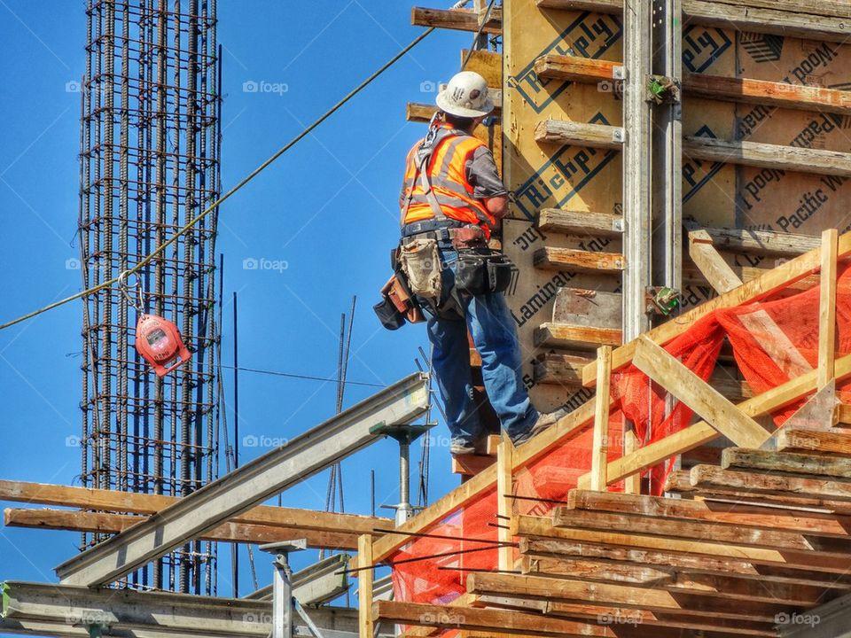 Workman Building A Skyscraper