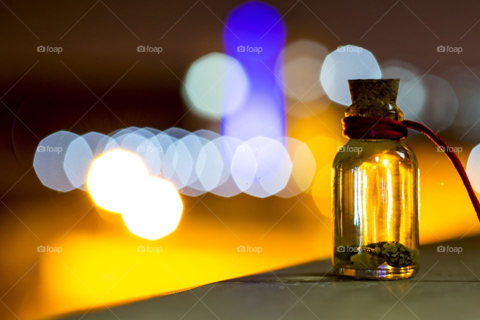 Seashells in glass bottle at night