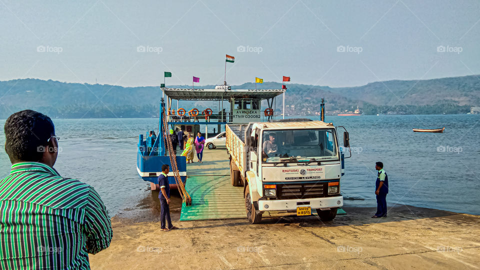 Transport Service with Boat for Vehicles and Public.