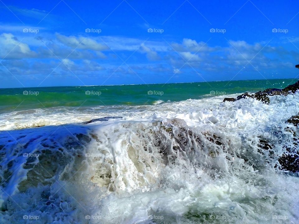 Scenic view of foamy ocean