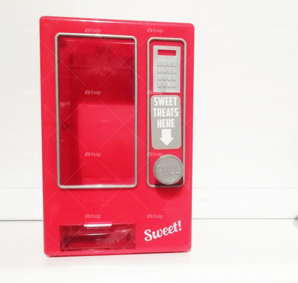 Sweet dispenser.  candy, red, dispenser, sweet, gum, colorful, machine, background, gumball, bubble, blue, white, vending, retro, coin, ball, dispense, food, vintage, isolated, chewing, penny, chew, treat, object, buy, color, glass, colors, slot,