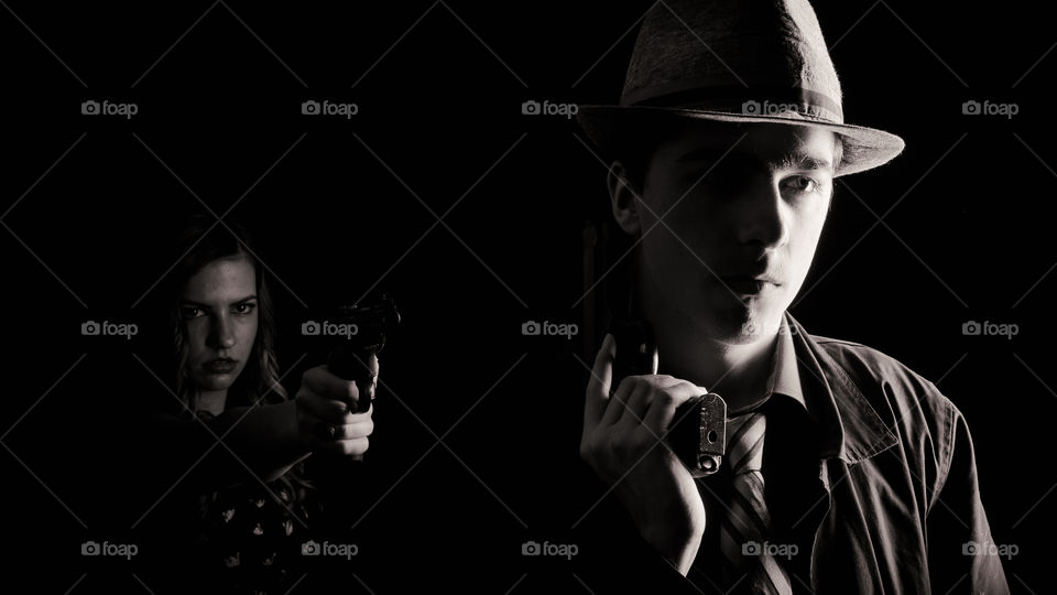 Man and woman holding gun