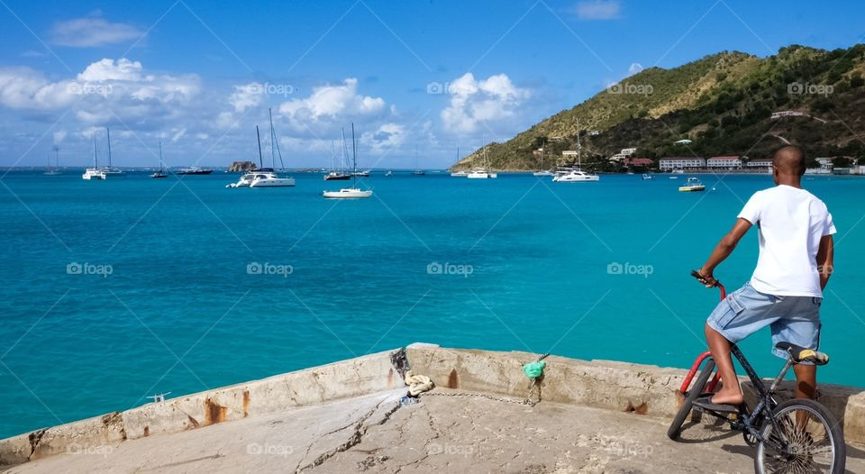Boy On Bike At The End Of A Pier, Boy Looking Into The Ocean, Pondering Boy, Island Views, Bicycling Boy, St. Maarten Grand Case