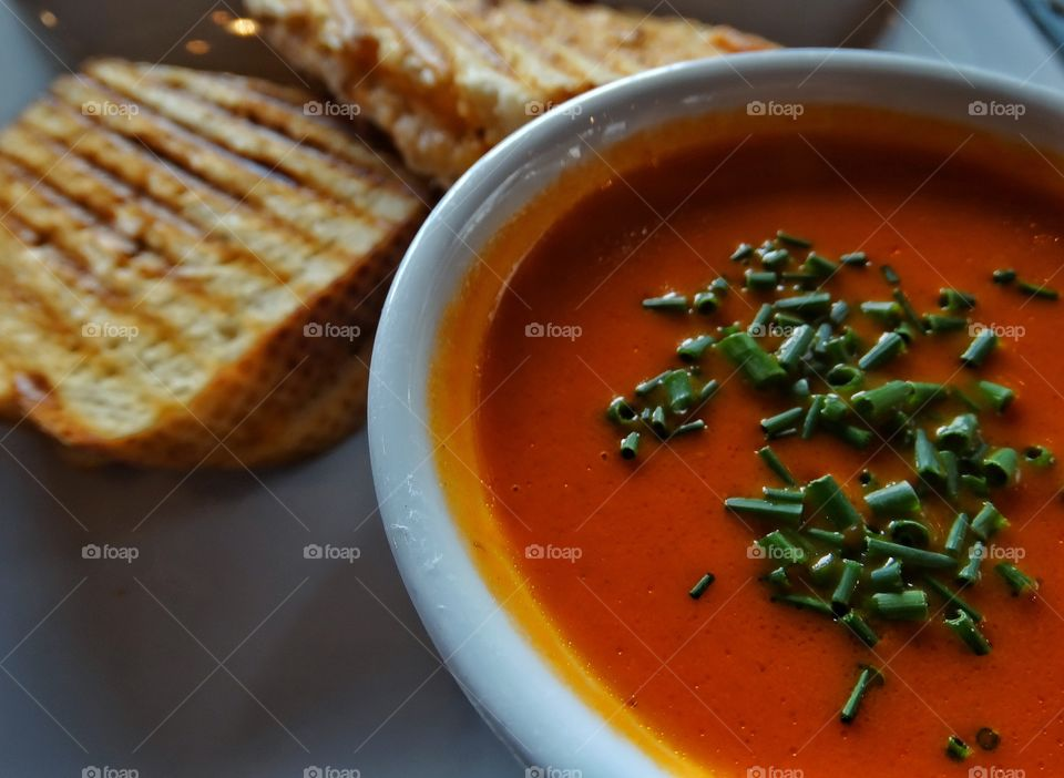 Comfort Food. Tomato Soup And Grilled Cheese Sandwich On A Rainy Day