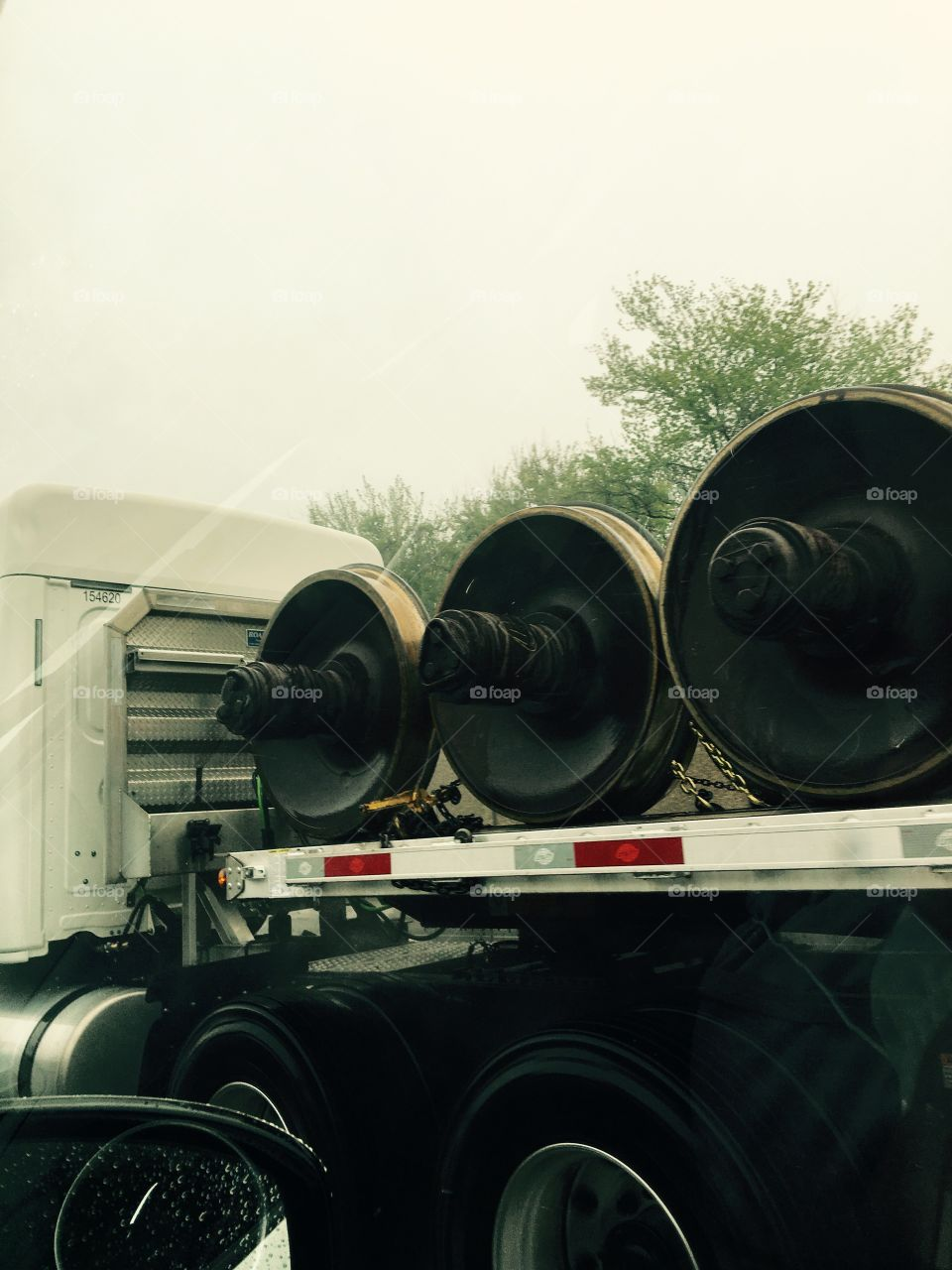 Truck carrying WHEELS FOR TRAINS