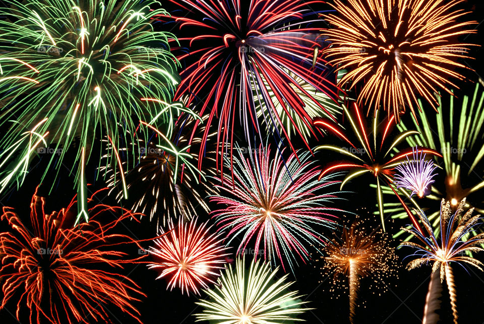 Multicolored fireworks display at night
