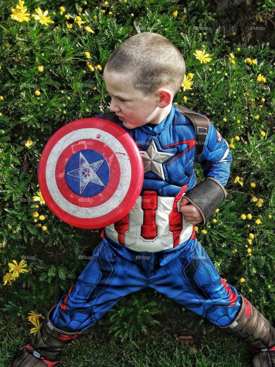 Boy wearing captain america costume
