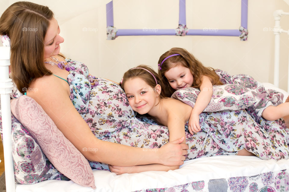Happy pregnant mother with two daughter