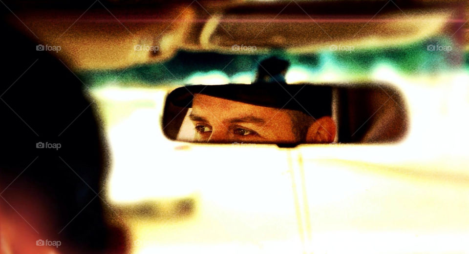 Face on rear view mirror