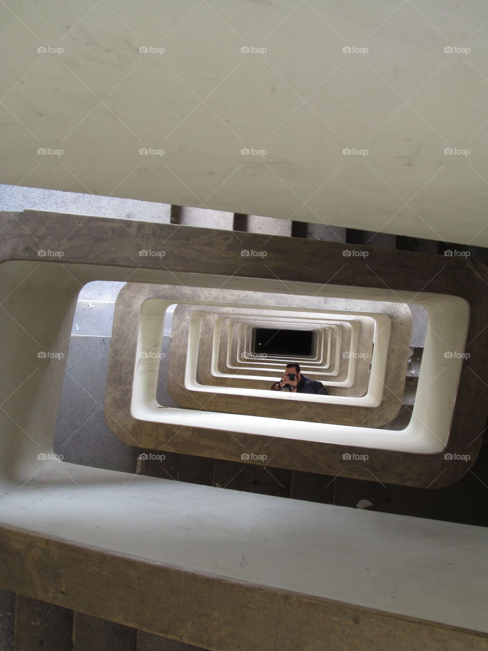 photographer under the stairs