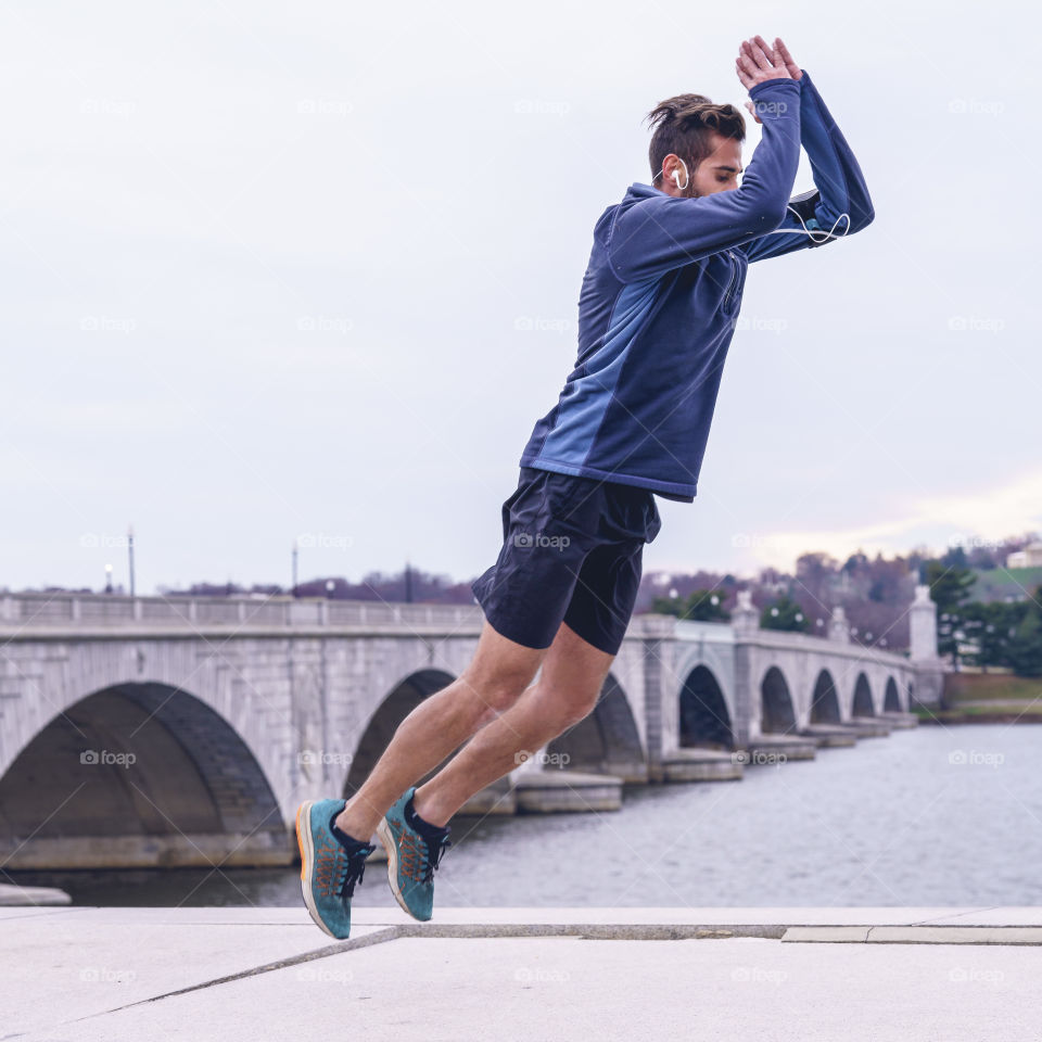 Man exercises near the Arlington Memorial Bridge