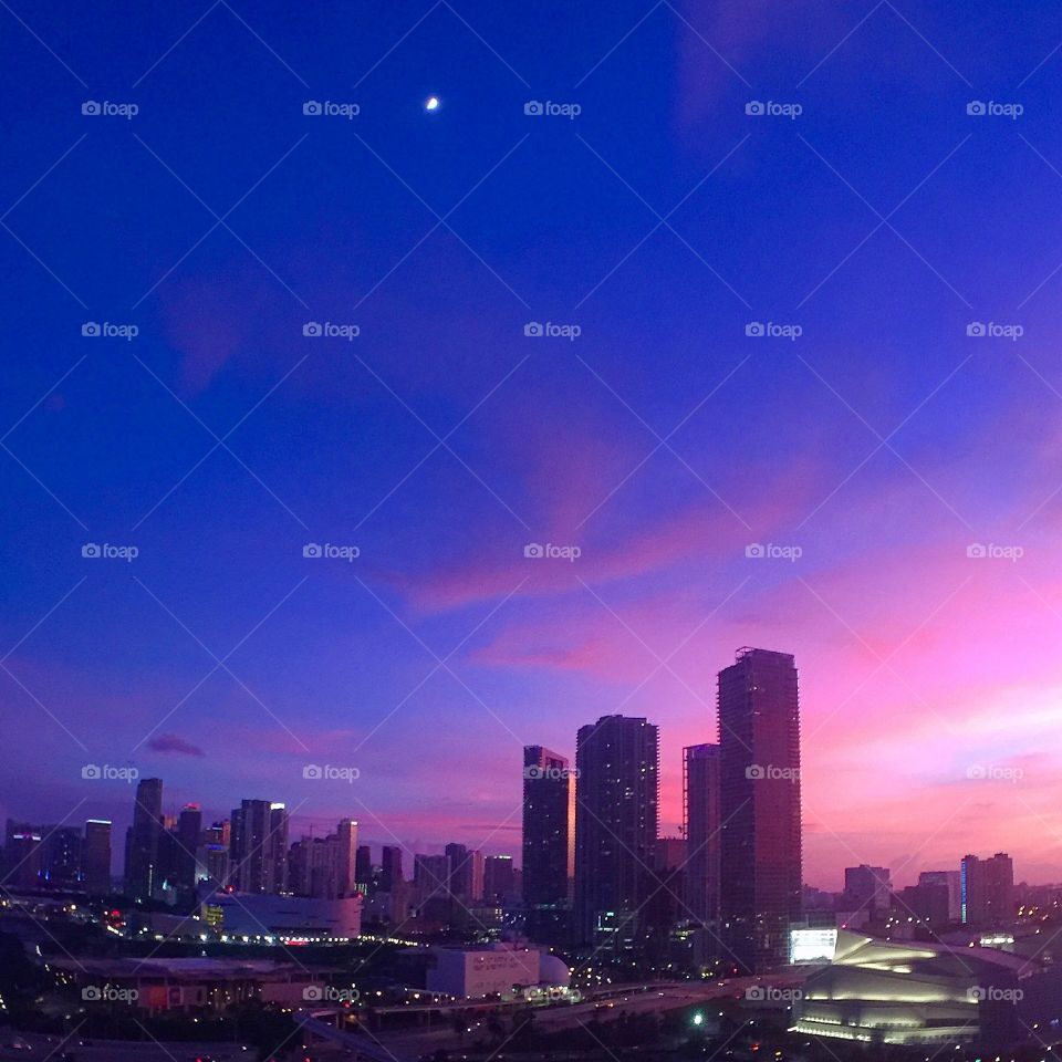 Sunset and half moon over downtown Miami