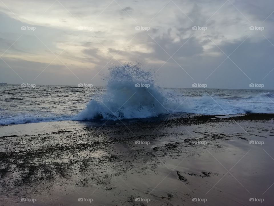 Sea water splashing on a evening