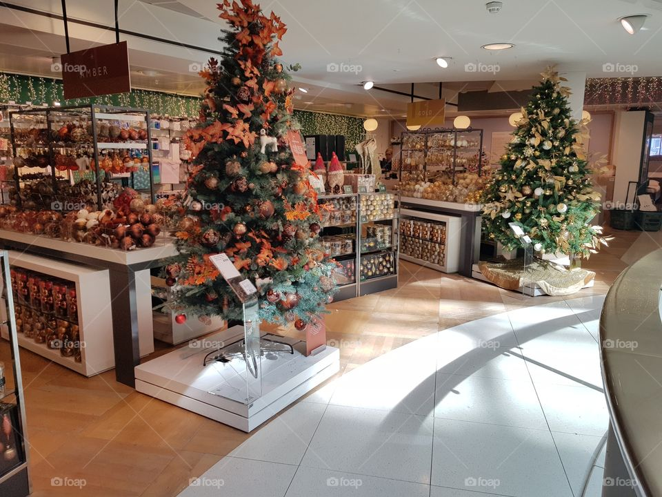 Christmas trees and decorations at Christmas shop at Peter Jones Sloane square Chelsea King's road London