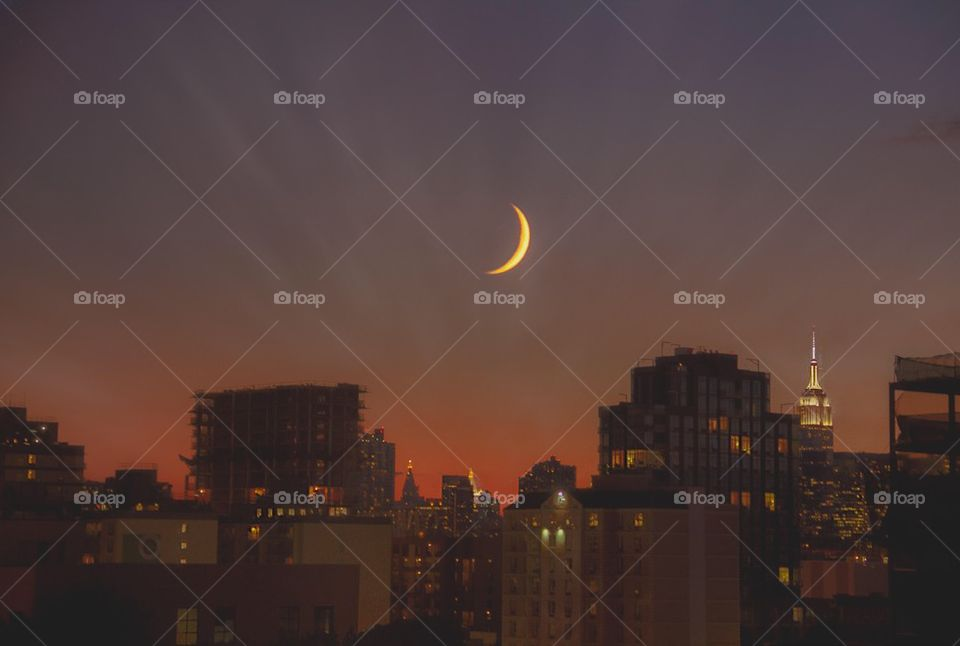 View of illuminated cityscape | crescent, sunset, building, city