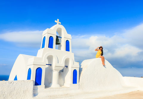 Attractive tourist and famous Santorini attraction, blue sky and sunny day, Mediterranean sea
