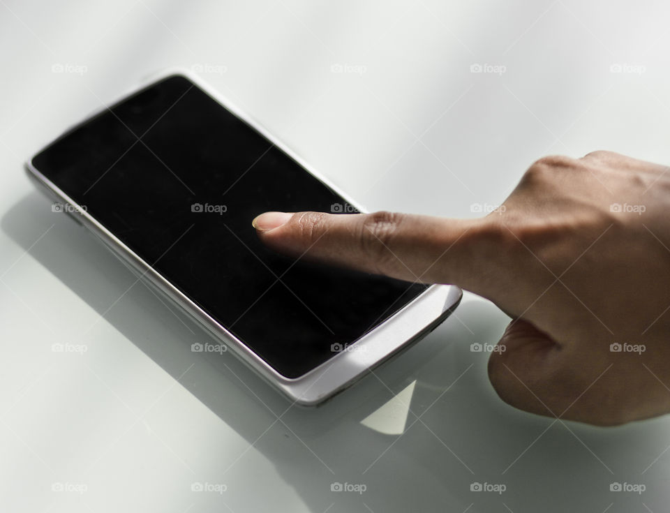 Touch screen. finger on mobile phone