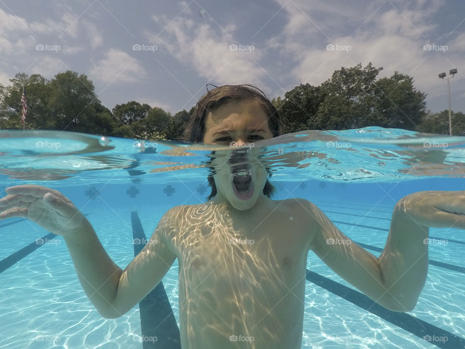Portrait of a Boy playing in a pool