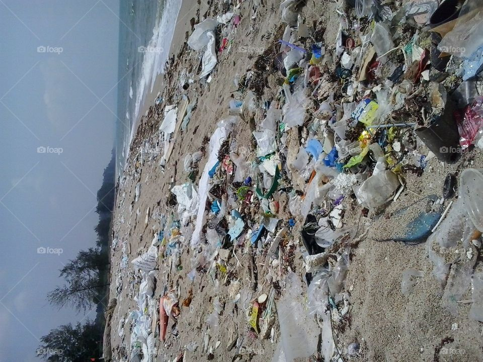 dirty beach full of rubbish,trash . sad reality