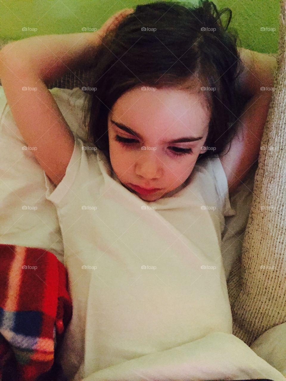 Cute girl leaning on sofa