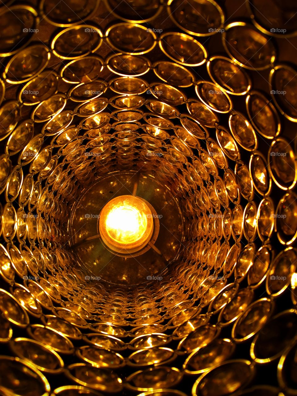 Close up light bulb in lamp. Golden abstract effect